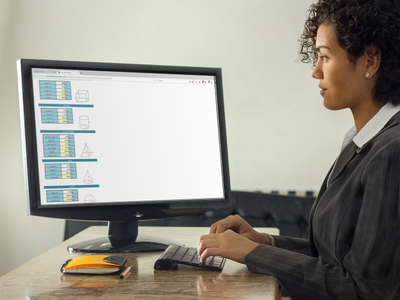 Photo of a woman working with an area and volume calculator on a desktop screen