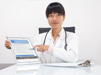 Photo of a doctor with a survey form on an iPad