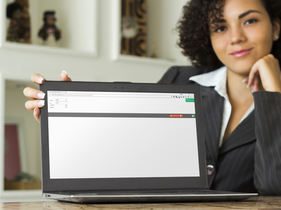Photo of a woman with a screen showing the currency converter calculator used in the tour