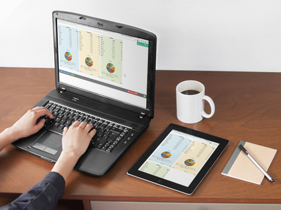 Photo of a laptop and tablet showing three and two columns of a calculator, respectively