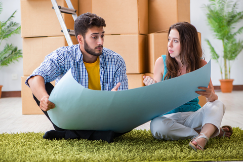 Photo of a young couple planning to refurbish their apartment