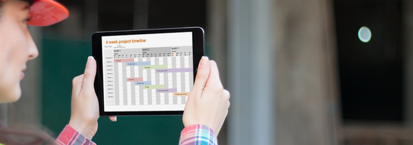 Photo of an engineer studying a project plan on an iPad tablet